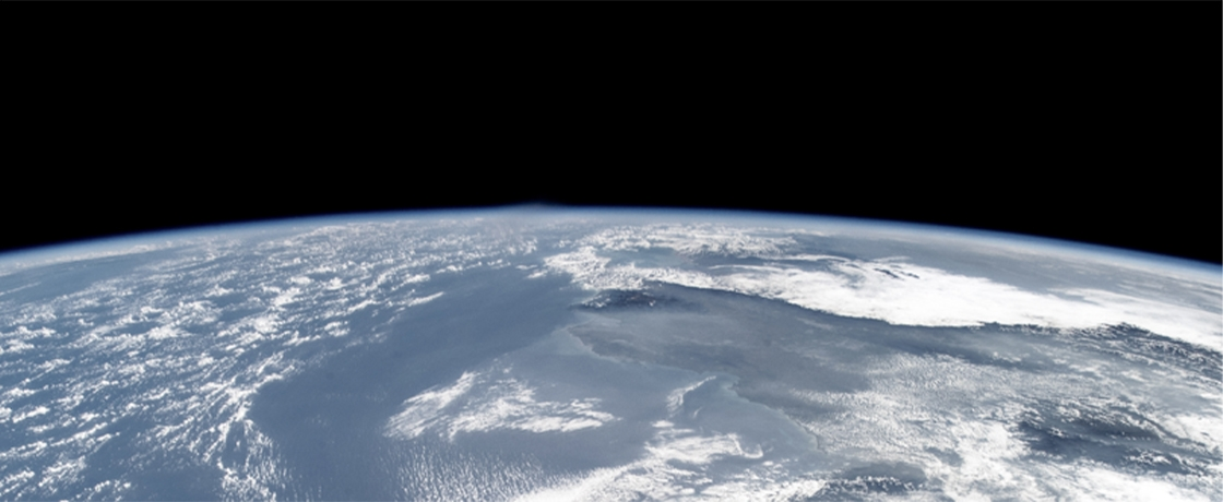 a partial photograph of earth from orbit showing the curvature of the planet
